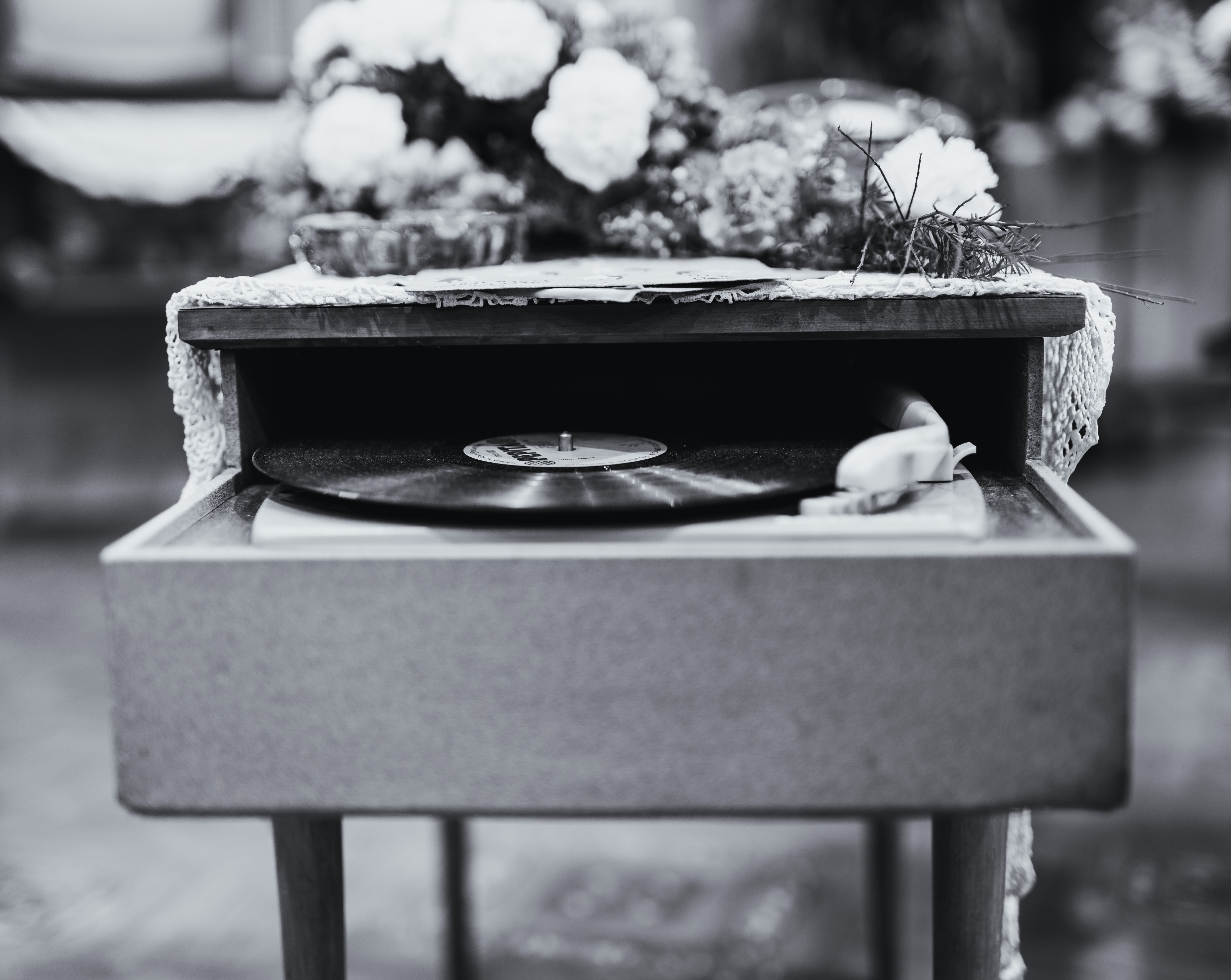 Grayscale Photo Of Vinyl Record Album Playing In Turntable
