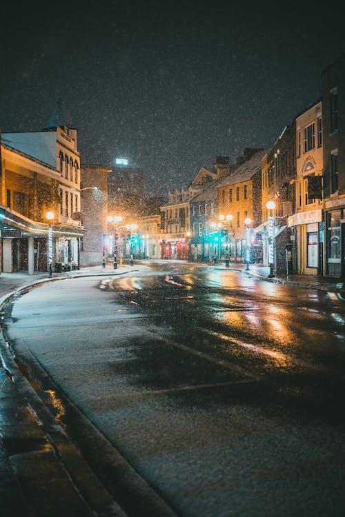 Glowing silent street in snowfall