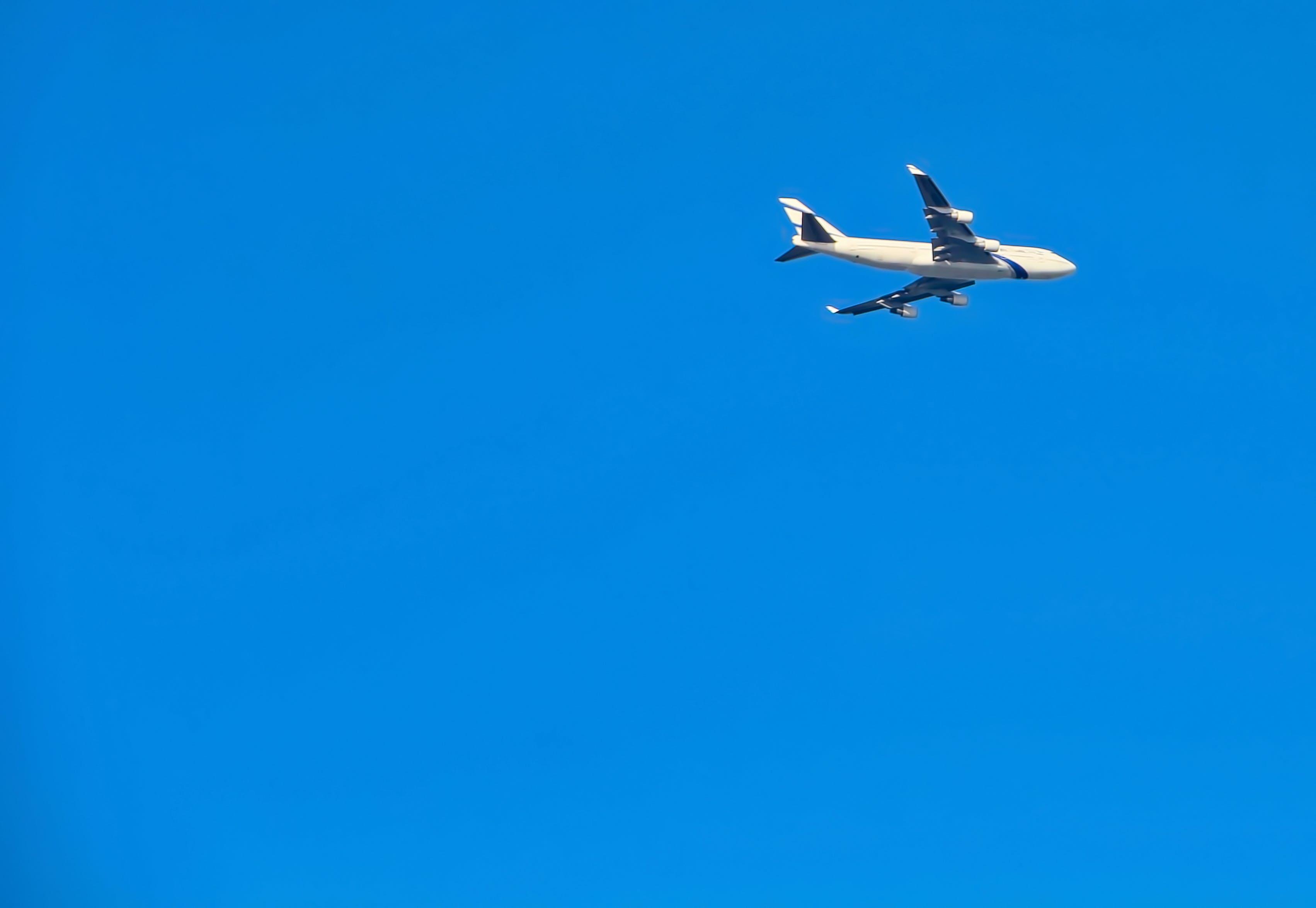 Timelapse Photography of White Passenger Plane in Sky