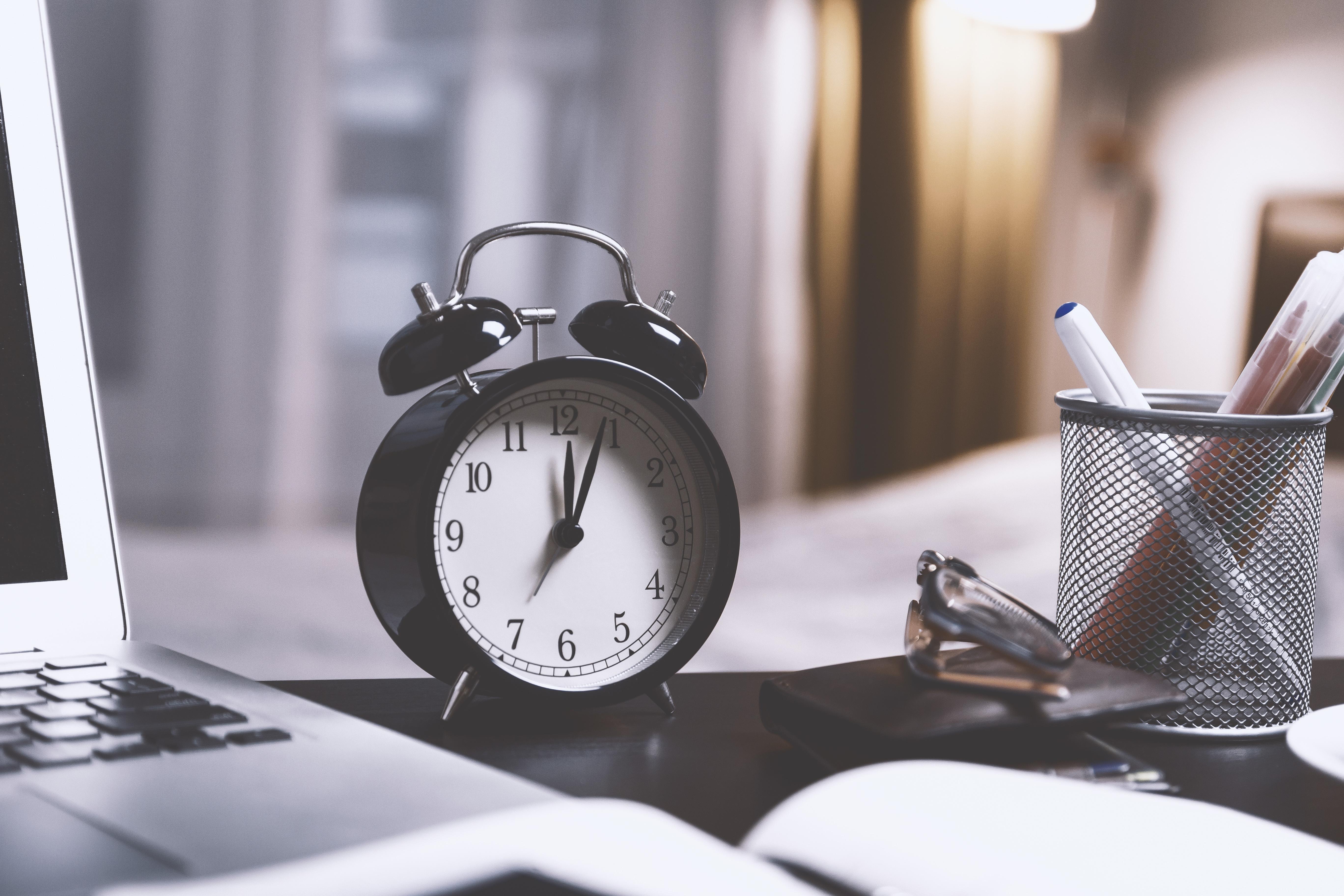 Black Twin Bell Alarm Desk Clock on Table - Hotcopy