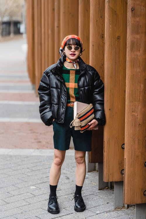 Fashionable woman in sunglasses on street