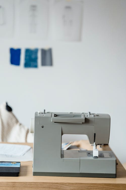 Sewing machine against wall with drafts