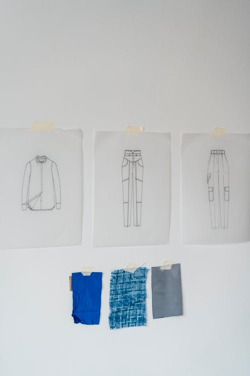 Fashion sketches hanging on wall