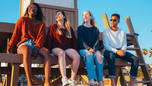 Group of Friends Sitting on Lifeguard Post