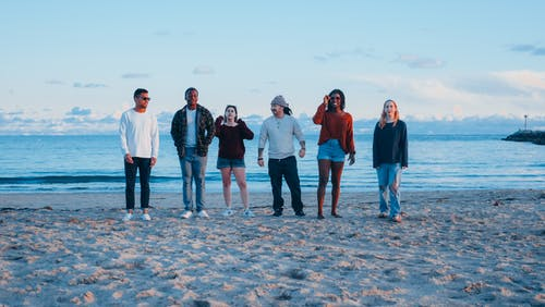 Group of Friends Standing on Beach Shore