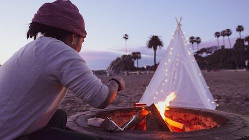 Man Starting a Bonfire