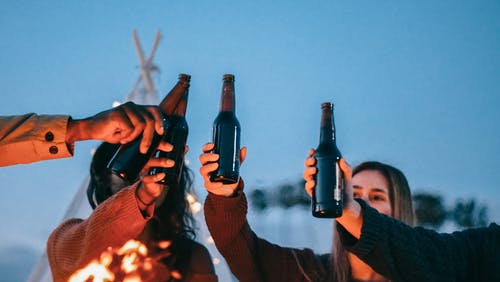 Group of Friends Clinking Beer Bottles