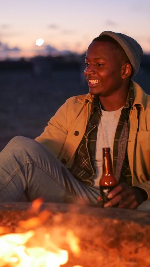 Man Holding a Beer Bottle