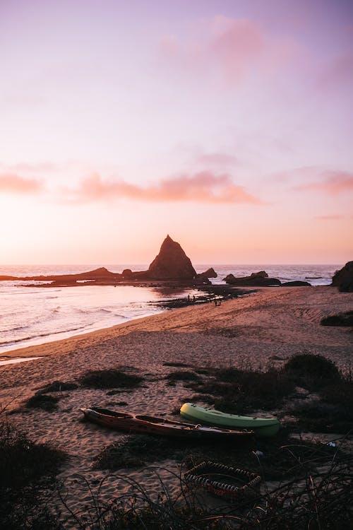 Green Kayak on Beach Shore during Sunset