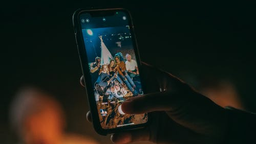 Person Taking Photo of Group of Friends