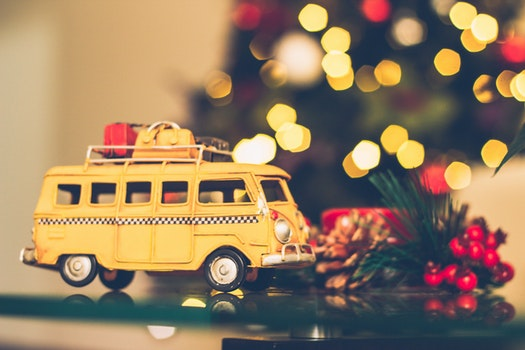 Selective Focus Photography of Yellow Vehicle Scale Model
