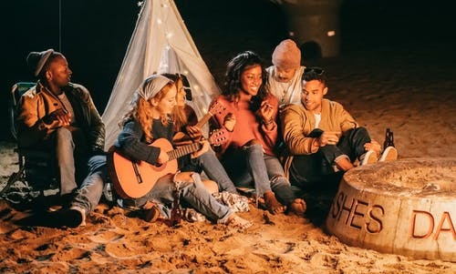 Group of Friends Sitting on Beach Sand