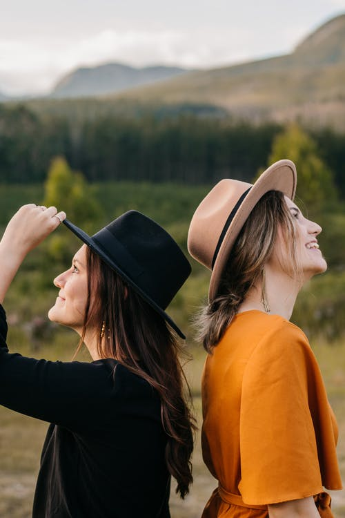 Cheerful women standing in countryside