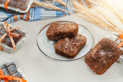 Brown Bread on Clear Glass Plate