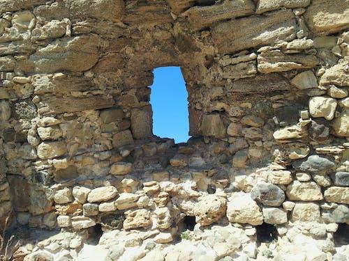 Free stock photo of blue sky, rock wall