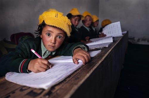 Children Writing in School