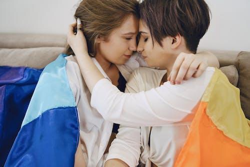 A Couple Drape with the LGBT Flag