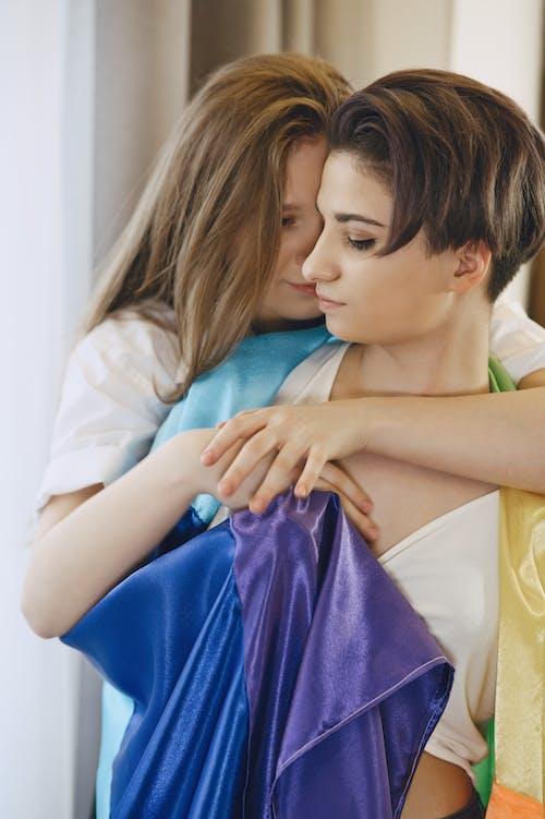 A Couple Drape with the Rainbow Flag