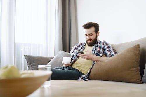 A Man Sitting on Sofa