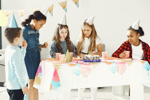 Kids Standing Near the Table