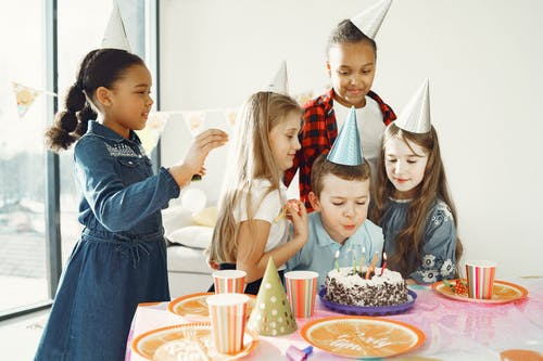 A Boy Blowing the Candles on the Cake