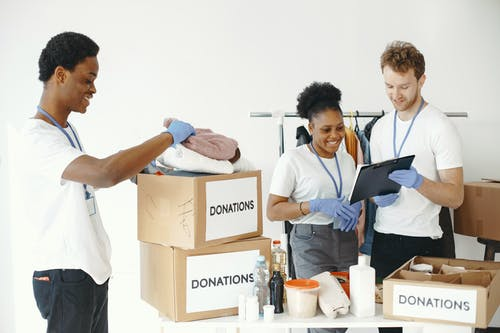 People Packing Donations