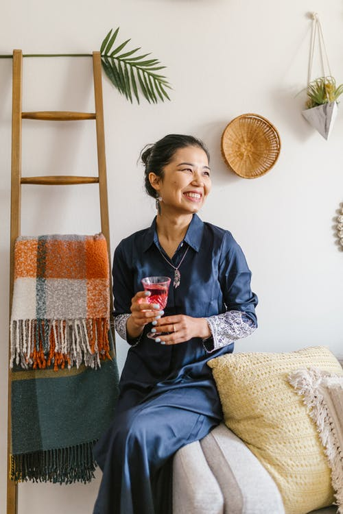 Smiling Woman Holding A Glass Of Wine