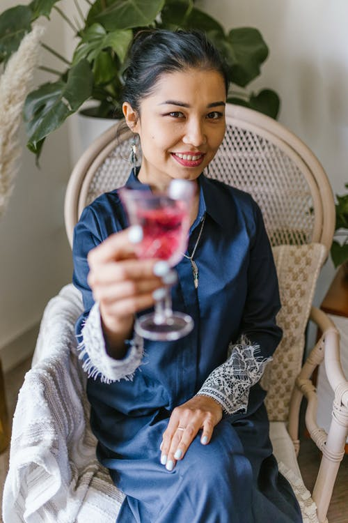 Woman Holding A Glass With Wine