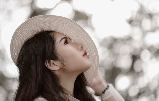 Woman Wearing White Hat See in the Sky