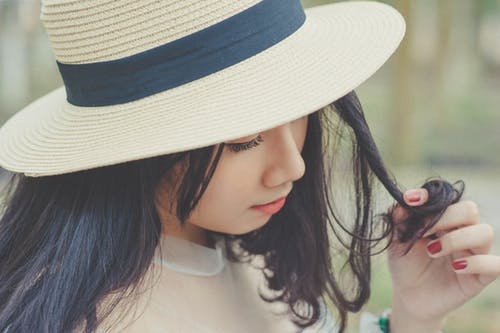 Selective Focus Photography of Woman With Brown Sun Hat