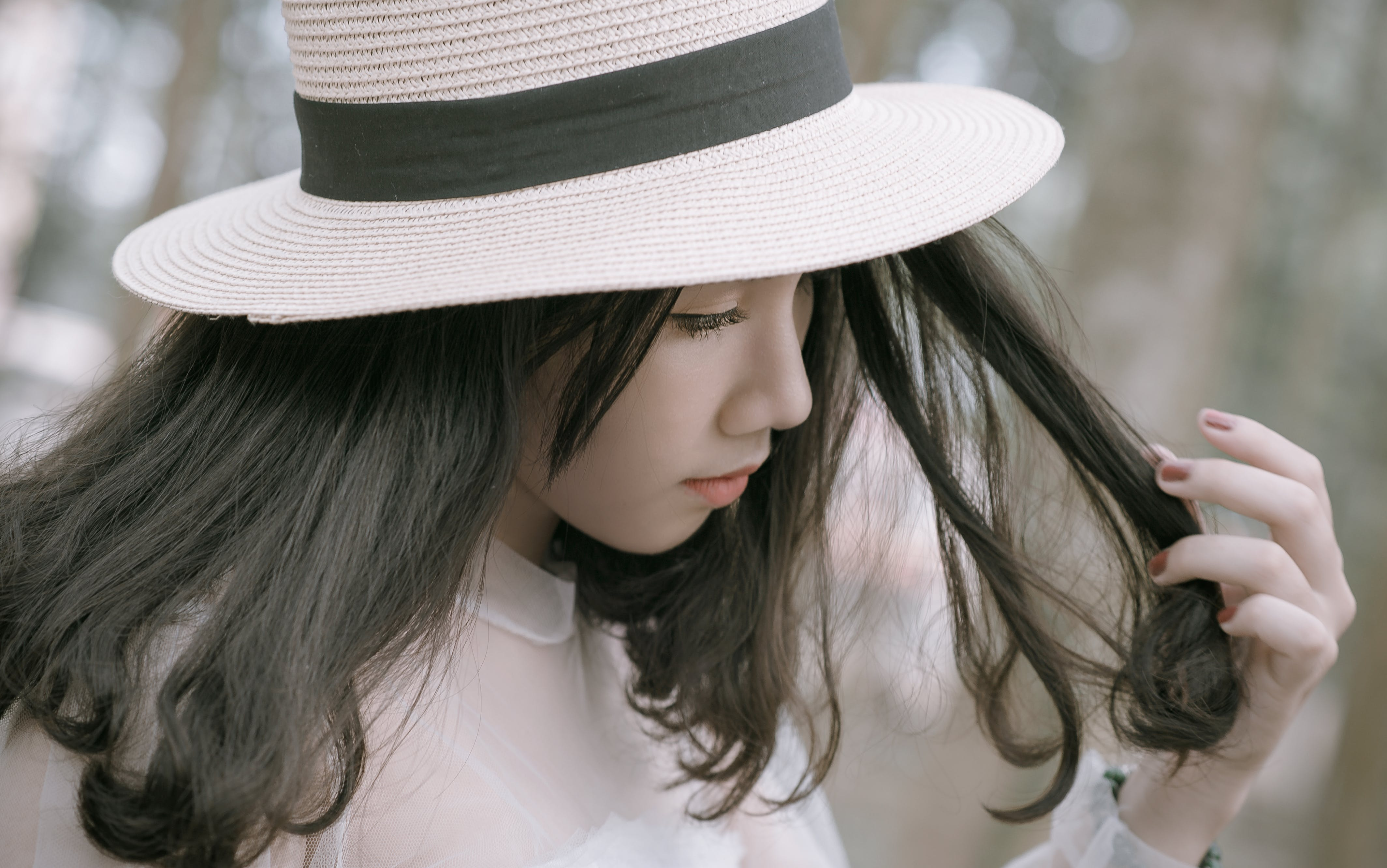 Woman Wearing White and Black Hat
