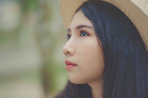 Woman Wearing Brown Fedora Hat