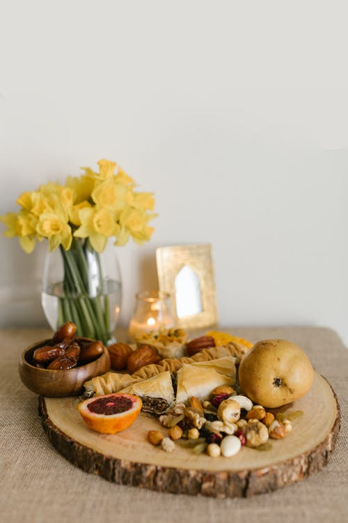 Fruits And Nuts On A Wooden Board