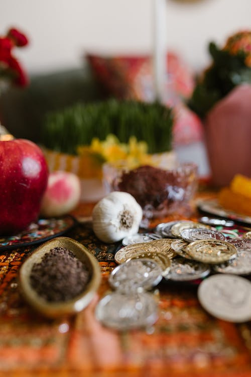 Traditional Food And Coins On Table