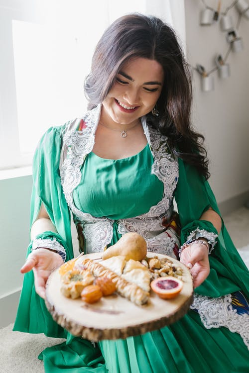 Woman Holding A Tray Of Food