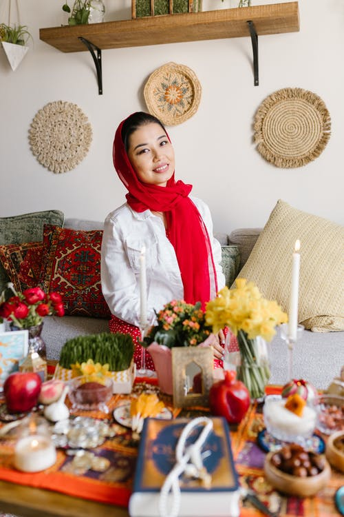 Woman Standing Beside A Table With Food