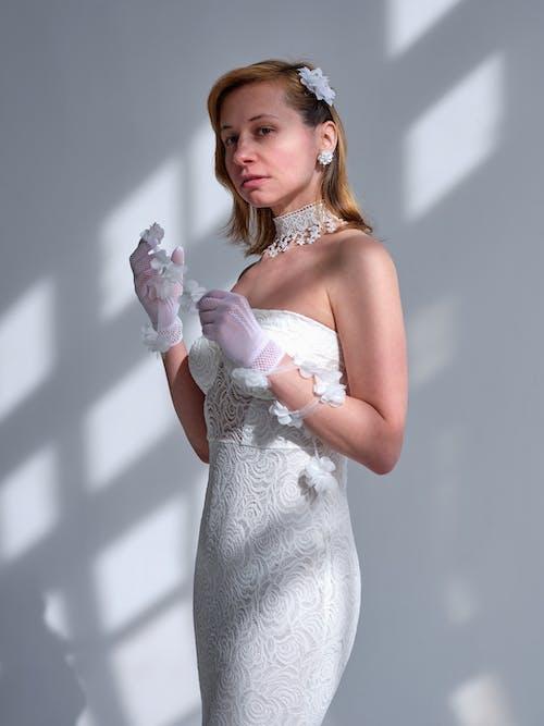 Graceful woman in elegant festive dress