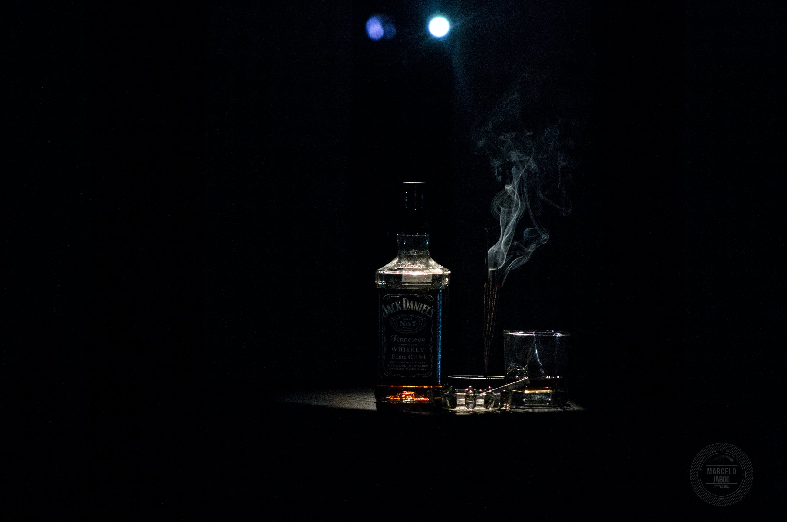 Closeup Photo of Liquor Bottle Against Black Background