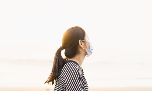 Woman in White and Black Striped Shirt Wearing White Framed Sunglasses