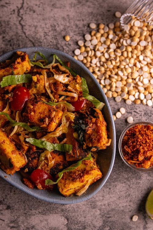 A Bowl of Cooked Food in a Bowl on a Rustic Background