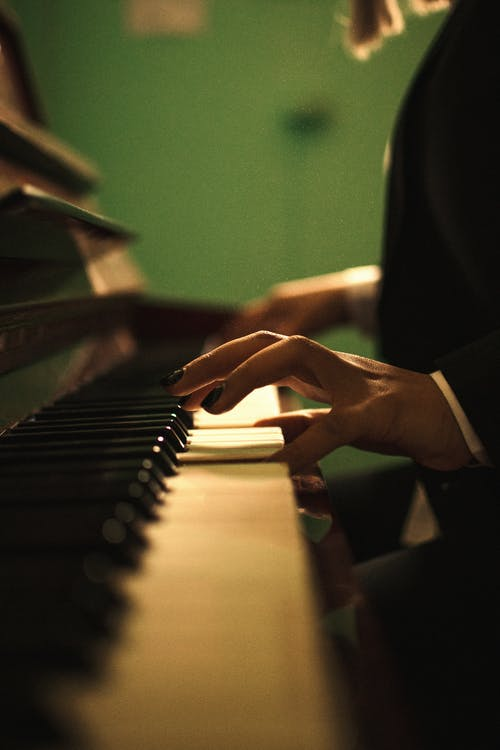 A Close-up Shot of a Pianist's Hands While Playing Piano