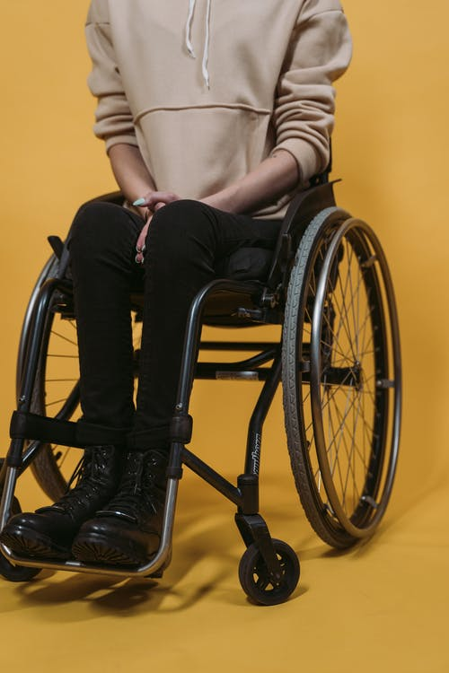 Person Sitting on a Black Wheelchair