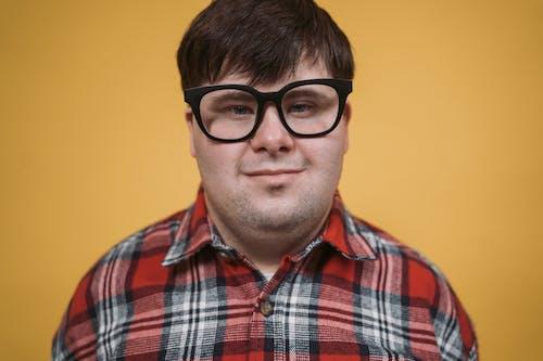 Close-Up Shot of a Man Wearing an Eyeglasses