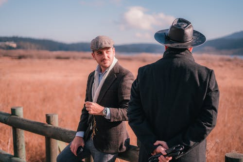 Men in the Countryside Farm Talking