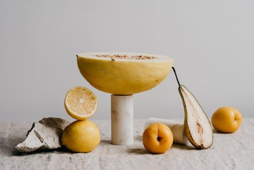 Gratis arkivbilde med appelsiner, beige toner, cantaloupe