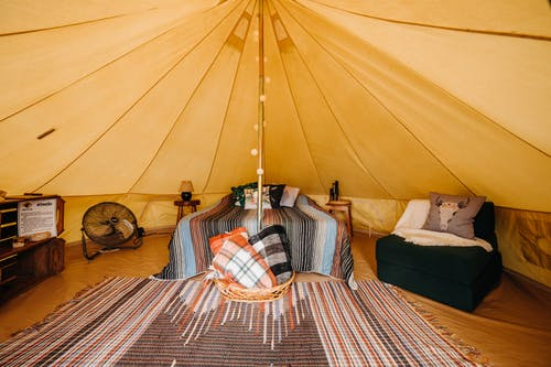 Tent with bed and armchair