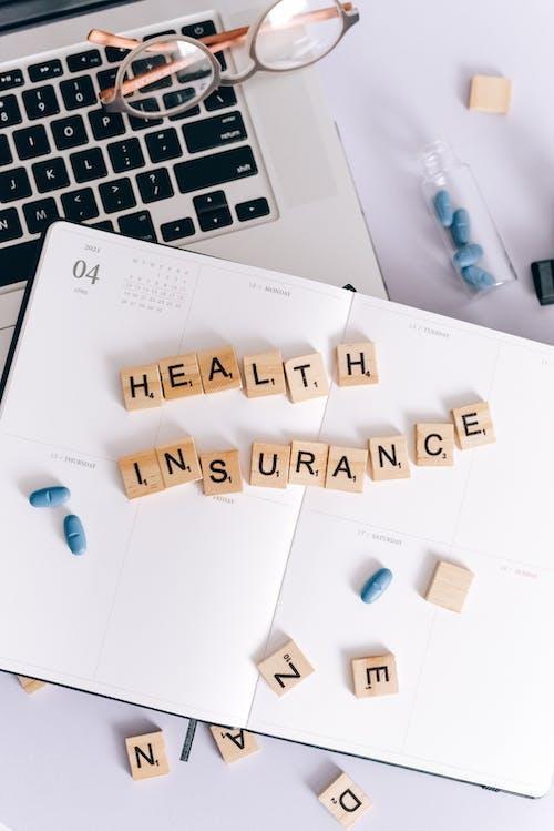 건강 보험, 공책, 달력의 무료 스톡 사진