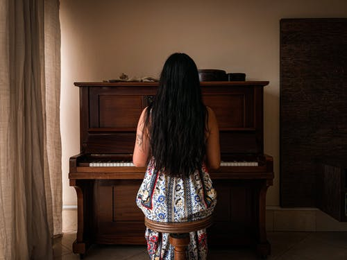 Back View of a Woman Playing Piano