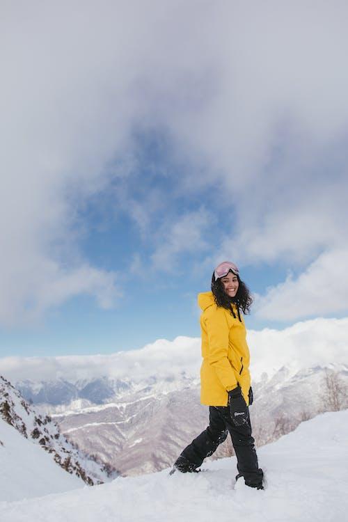 A Woman in Ski Wear on Snowy Mountain