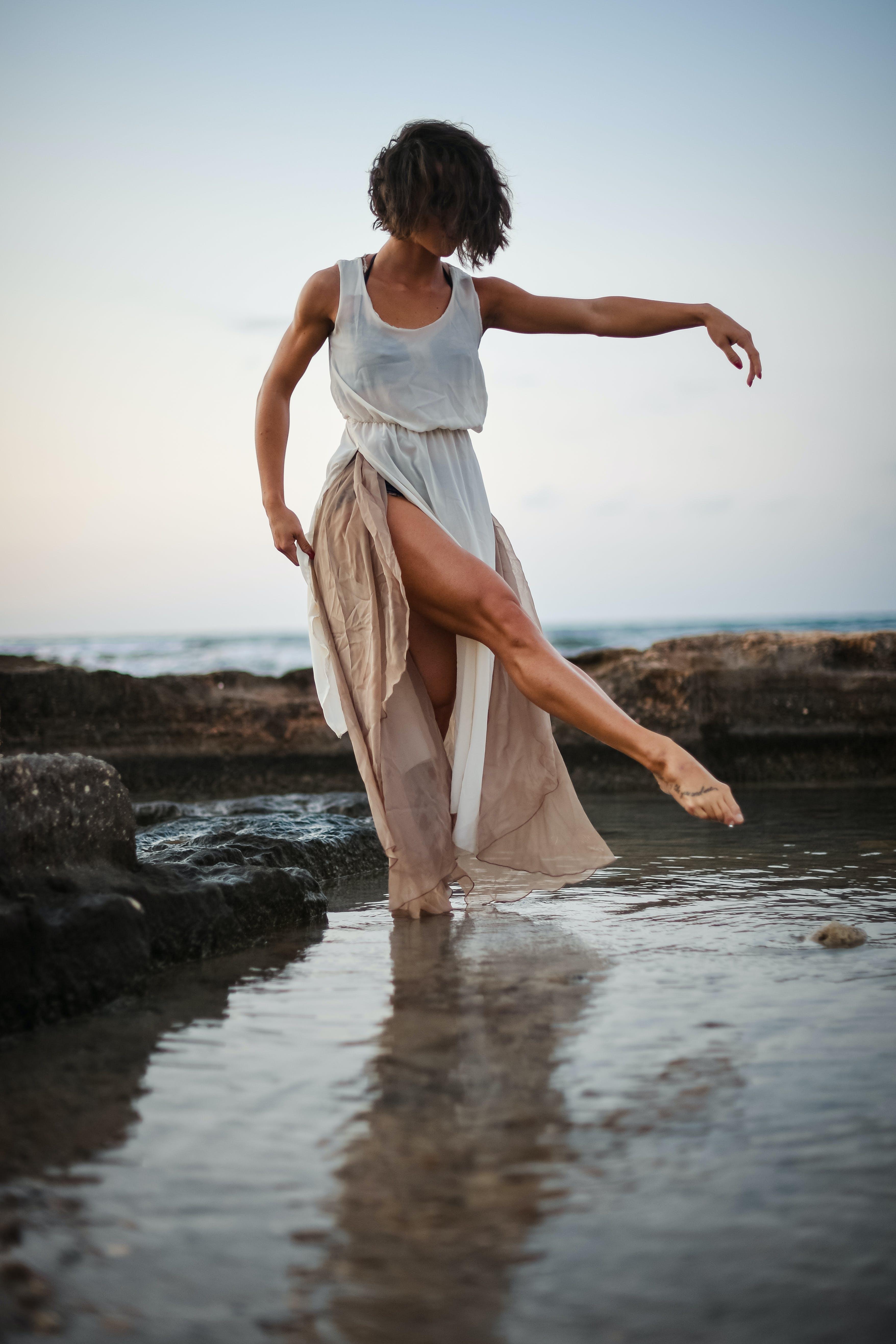 Woman Wearing White Tank Dress Posing in Body of Water